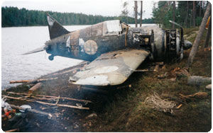 Brewster-372 fighter plane. The Nokian Nopsa pushcart tyre was the tailwheel on the plane being lifted out of the wilderness lake.