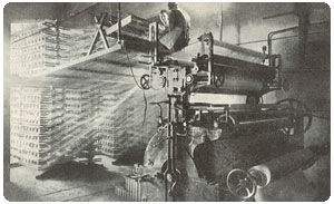 Weaving machine in motion. Rubberising the cord required for tyres.