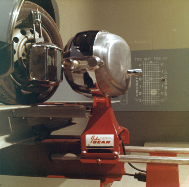 The new equipment at the tyre laboratory included a John Bean optical steering alignment checker.